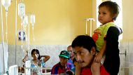 Leonidas Pacunda carries his son Isbac on his shoulders at Las Mercedes hospital in Chiclayo, Peru, Saturday Jan. 28, ...