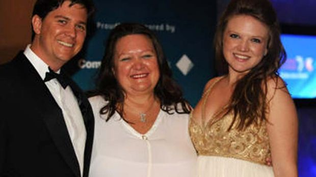 In happier times… Rinehart with estranged son John Hancock and youngest daughter Ginia Rinehart, who has stood by her ...