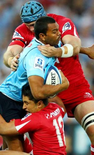 No longer a threat ... Former Waratah Kurtley Beale in last year's round two clash against the Reds.