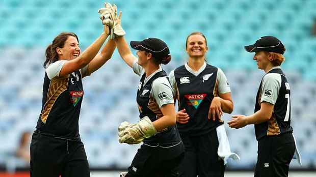 New Zealand's Kate Broadmore high-fives with wicketkeeper Katey Martin after having Australia's Sarah Coyte stumped.