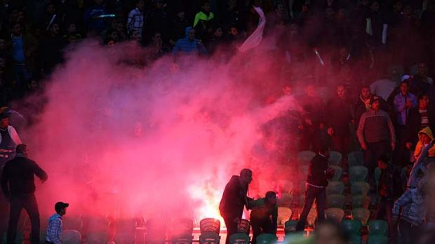 Riot ... scores are dead after fighting broke out following the match between Al-Ahly and Al-Masri.