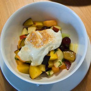 Fruit salad with honey-infused yoghurt and a sprinkling of cinnamon from The Parlor in Beaumaris.
