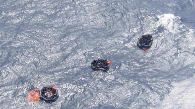 Life rafts carry survivors from the capsized ferry off the PNG coast.