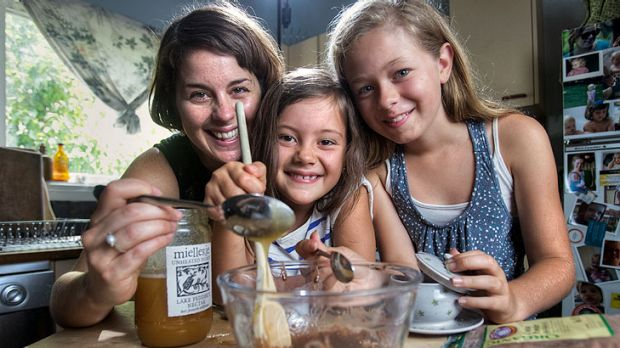Westgarth naturopath Ali Gould cooks with her daughters Anaya, 7 (centre), and Christa, 11, to encourage a healthy ...