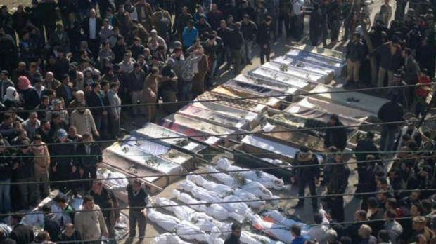 Mourners gather at the funeral  of  victims reportedly killed on Saturday  in  Homs province.