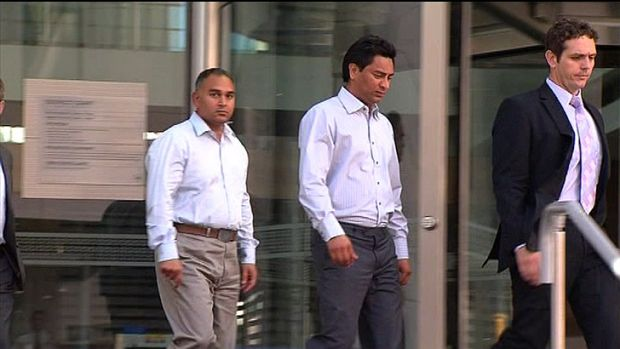 Prabhjit Gill (L) and Amrit Singh (R) with their lawyer Steven Shadgett outside District Court.