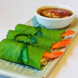 Fresh green mustard-leaf rolls with prawn, pork and rice noodles, and chicken liver dipping sauce.