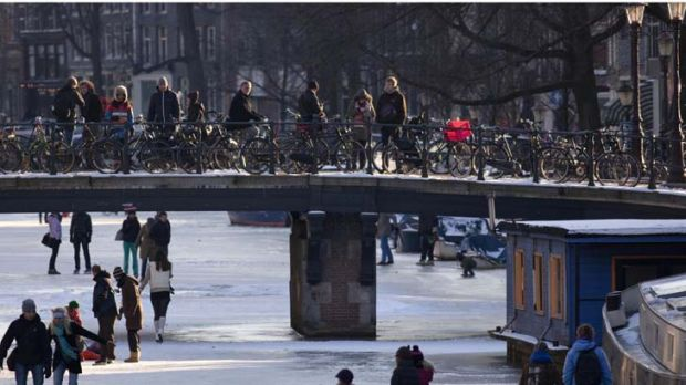 Snap to it … people skate on the Keizersgracht canal in Amsterdam. Cold weather means the Dutch might be able to ...