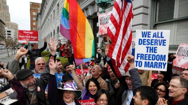 Gay marriage advocates cheer during a rally moments before hearing the news of the Proposition 8 over-ruling.