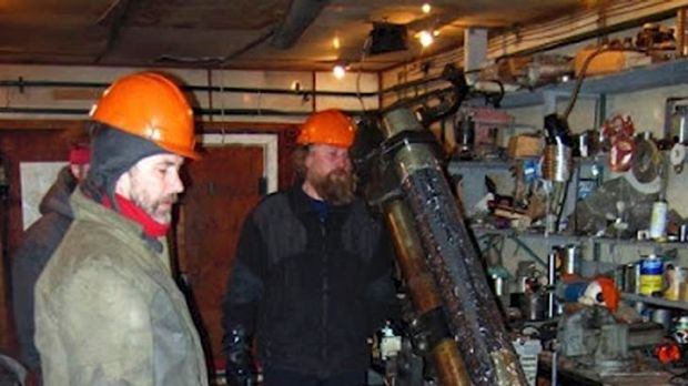 Researchers work with drilling apparatus at the Vostok camp in Antarctica.