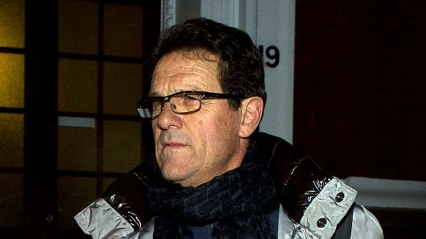 Fabio Capello leaves his central London home yesterday, a day after resigning as England manager.