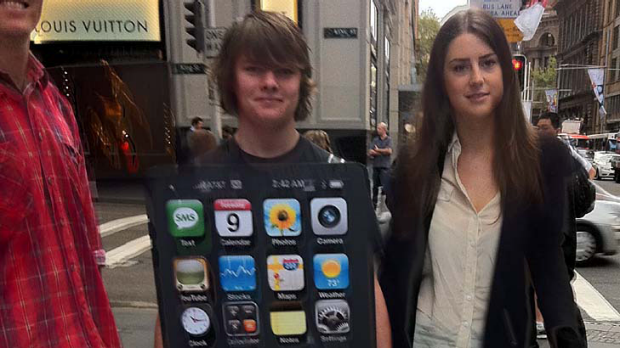 Activists in Sydney deliver the 250,000-strong petition to the Apple store this morning.