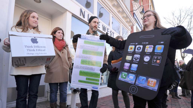 Amanda Kloer of Change.org speaks to reporters during a protest  in front of the Apple store in Washington, DC.