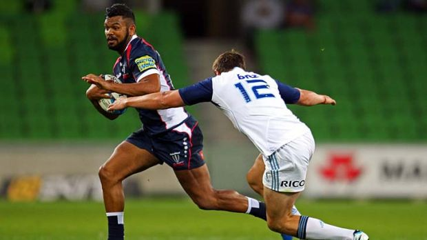 Start me up: Melbourne Rebels' Kurtley Beale makes a break against the Blues last night.