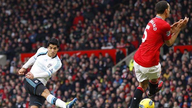 Luis Suarez scores for Liverpool.