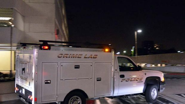 A Beverly Hills police crime lab truck leaves the Beverly Hilton.