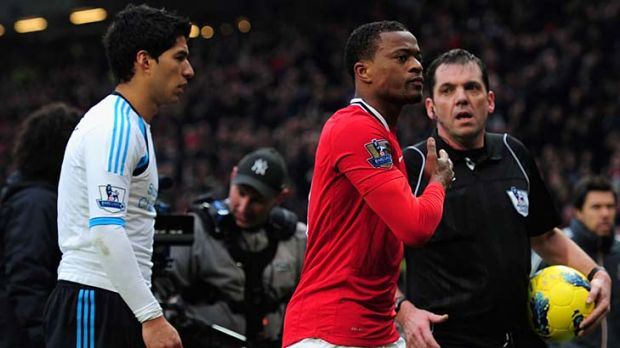 Controversial gesture: Patrice Evra celebrates Manchester United's 2-1 win after Liverpool's Luis Suarez refused to ...