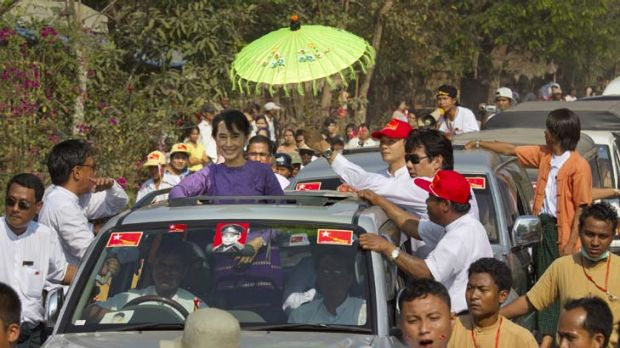 Wild welcome … Aung San Suu Kyi stands in her car so crowds can see her as she campaigns for the first time in Kaw ...