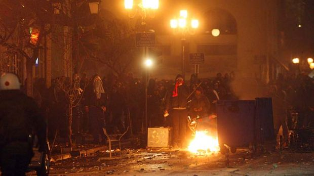 Angry ... protesters clash with riot police in Thessaloniki.