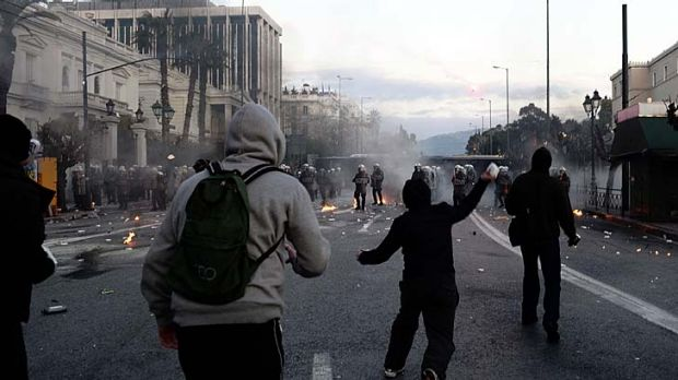 Making their point ... protesters clash with riot police in front of the Greek Parliament in Athens.