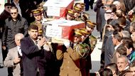 Mourners carry the coffins of people killed in two bomb blasts which occurred on Friday, at al-Eiman Mosque in Syria's ...