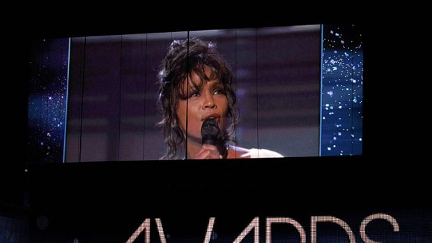 A performance by Whitney Houston at the 1994 Grammys is played on a screen at this year's awards.