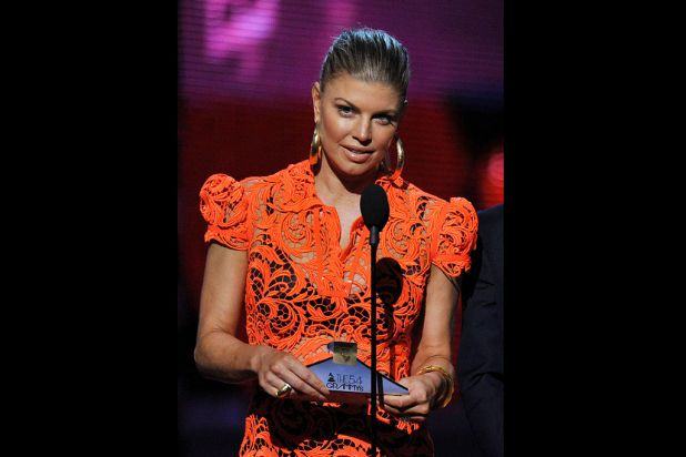 Fergie of the Black Eyed Peas presents an award.