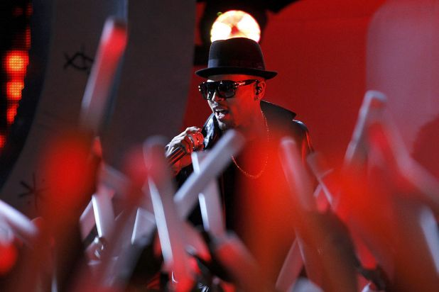 Chris Brown performs outside the Grammy Awards venue.