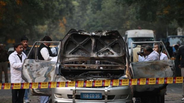 Bomb blast ... Indian police investigate after an explosion tore through a car belonging to the Israel Embassy in New Delhi.