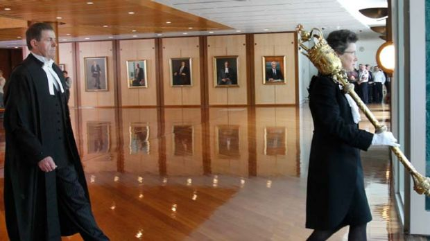 Behind you all the way ... the Speaker, Peter Slipper, follows the serjeant-at-arms through the halls of Parliament to ...