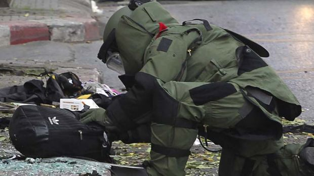 """""""Attempted terrorist attack"""" ... a bomb disposal expert examines the evidence."""