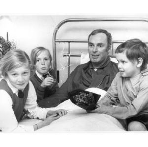 Hey Dad … Bruce Gyngell in hospital in 1970 with children, from left, Briony, 9, Skye, 7, and David, 4.