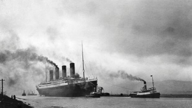 Ill-fated ... the Titanic, guided by tugs.