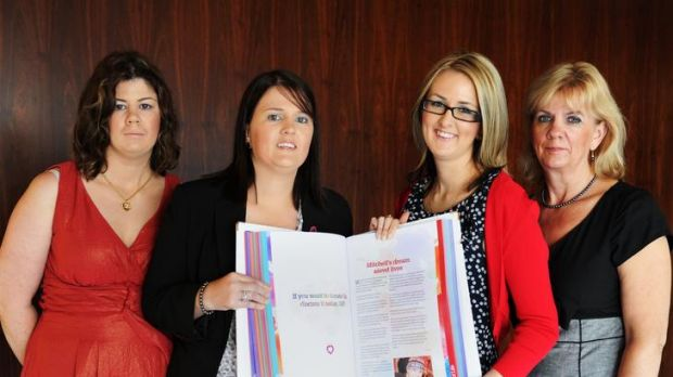 Hayley Brennan, Chloe Brennan, Melanie Plant, and Sonja Brennan, with the updated Book of Life, open at the page of ...