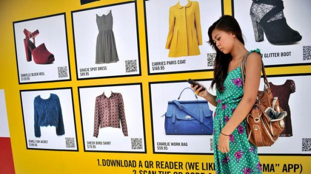 Shopper Emily Tran hunts for a bargain with her iPhone at Sportsgirl in Chapel Street. The virtual shop is ideal for ...