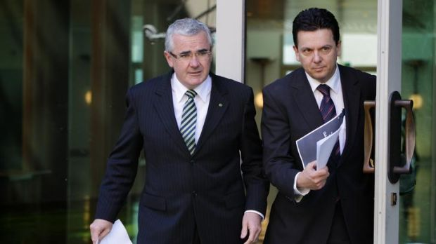 Independent MP Andrew Wilkie, left, and independent Senator Nick Xenophon. Mr Wilkie has threatened to vote against the ...