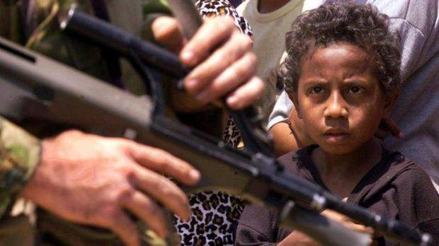 Despite the look of apprehension on this boy's face, Australian peacekeeping soldiers were welcomed by the East Timorese ...