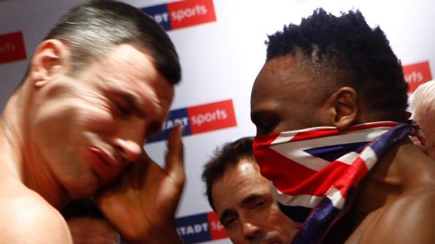 Slap in the face ... British boxer Dereck Chisora hits Vitali Klitschko in the face.