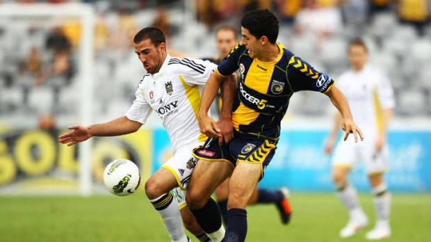 Tomas Rogic of the Mariners competes with Emmanuel Muscat of the Phoenix during the round 20 A-League match between the ...