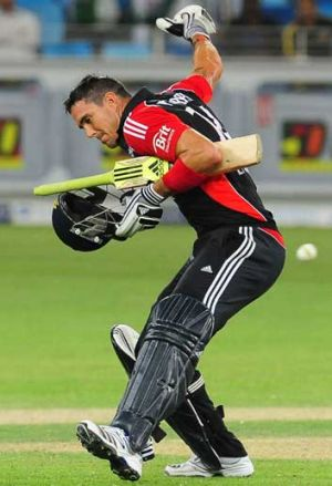 England's Kevin Pietersen celebrates reaching his century against Pakistan in the third one-day match in Dubai.