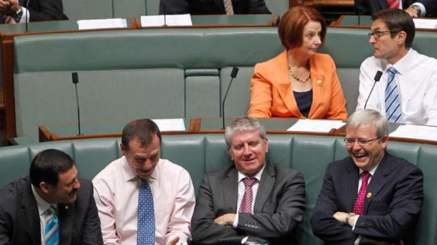 Foreign minister Kevin Rudd talks with MPs Mike Kelly, Graham Perrett and Brendan O'Connor as Prime Minister Julia ...