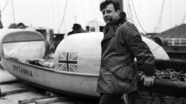 Fairfax stands beside his 22-foot rowing boat, Britannia, at King George V Dock in London, prior to his Atlantic crossing.