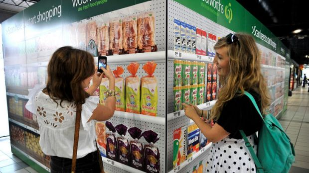 Food for thought ... Alana Pozzebon (left) and Liv Cougan check out the Woolworths virtual supermarket.