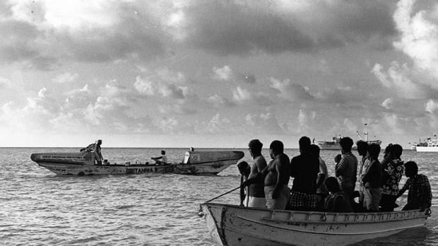 Fairfax and Cook leave the Gilbert Islands on their way to Australia by rowboat.