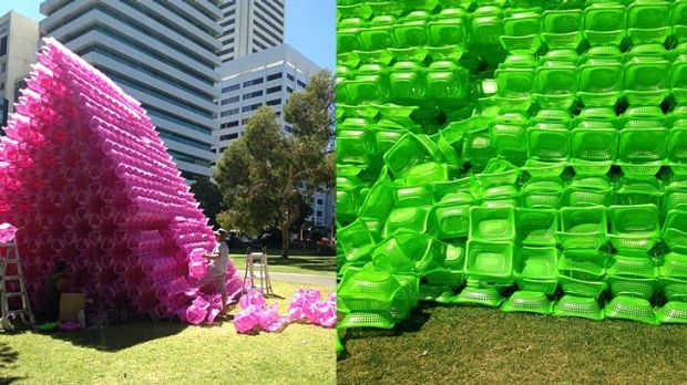 Artist assistants repair the damage to Choi Jeong Hwa's work in the CBD.