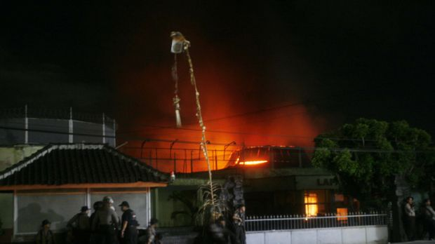 Damage ... Bali's Kerobokan jail is lit up by fire.