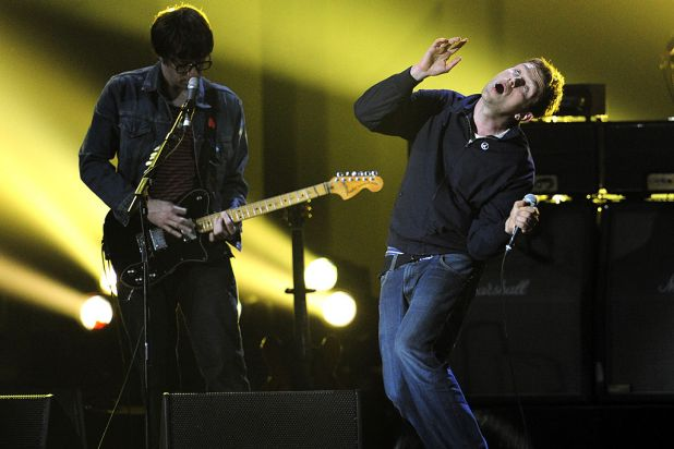 Blur's Damon Albarn (right) and Graham Coxon (left) perform on stage.