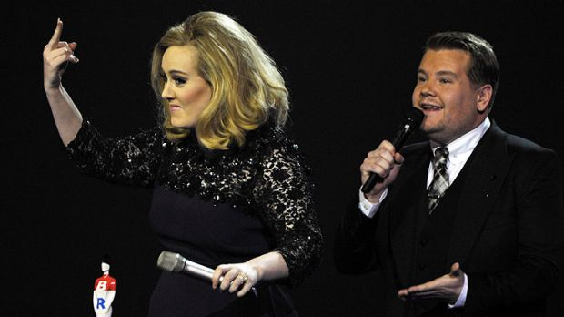 Adele raises her middle finger after being cut while giving an acceptance speech.