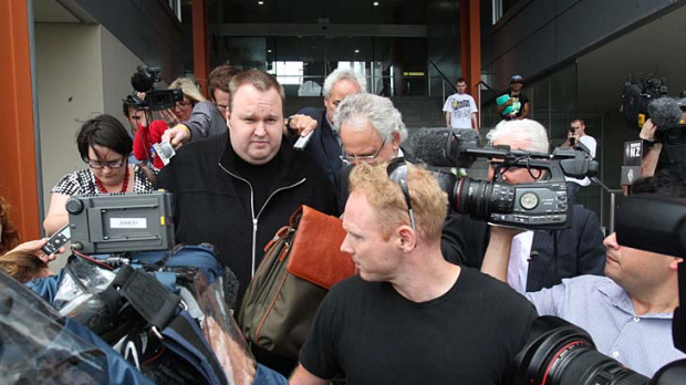 Kim Dotcom leaves North Shore District Court in Auckland.