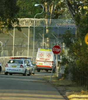An ambulance leave Villawood Detention Centre.